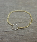 Delicate gold ring with a chain