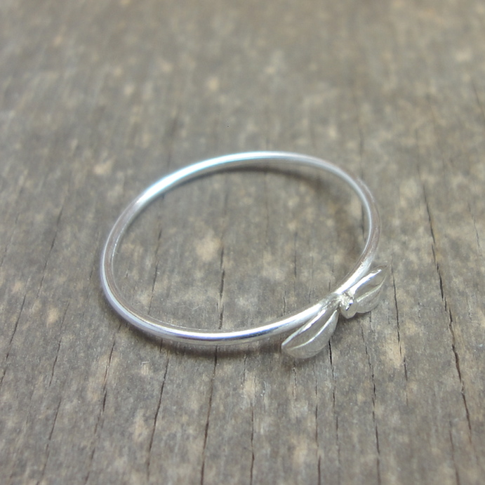 Silver ring with small flower leaves